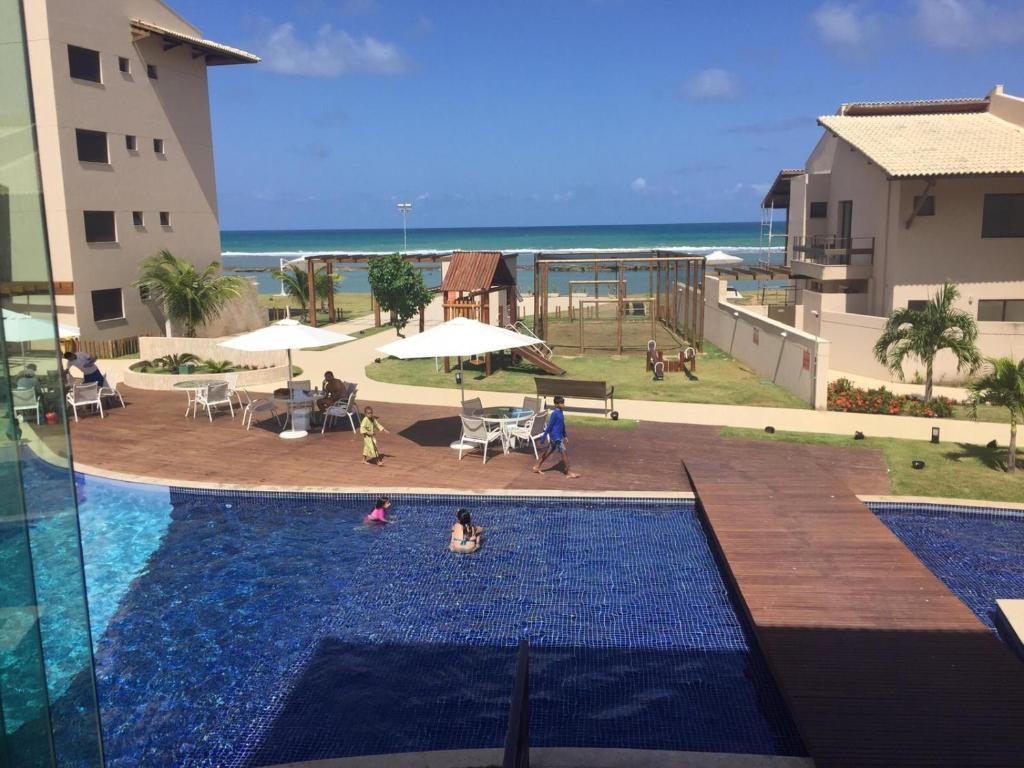 Uma vista da piscina em Flat Muro Alto ou nos arredores