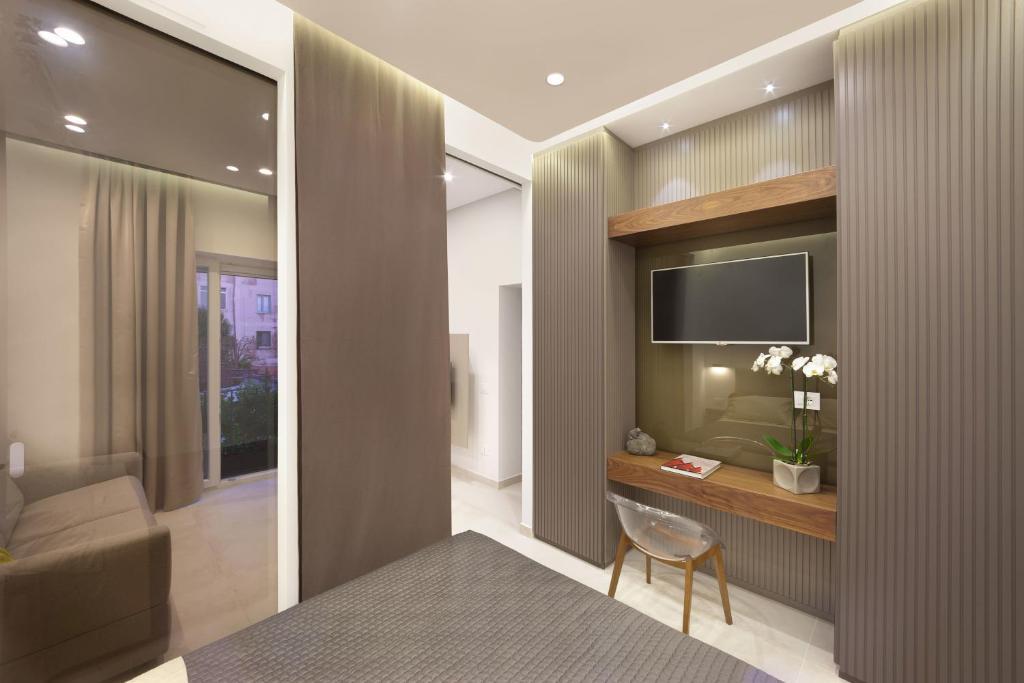 TV o dispositivi per l'intrattenimento presso Surreo Luxury Bed & Breakfast