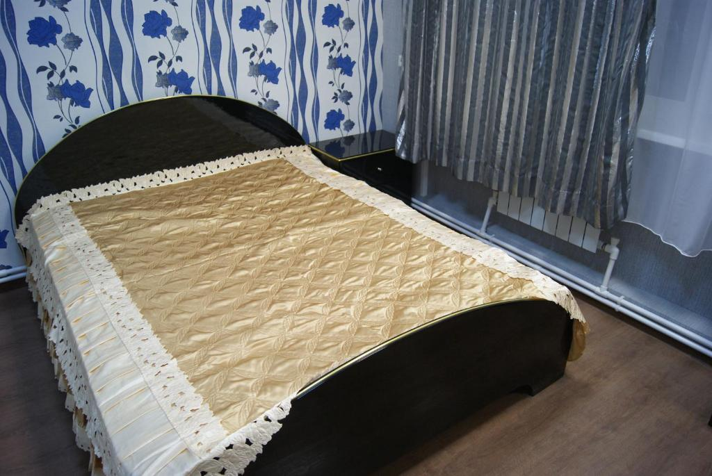 A bed or beds in a room at Hostel Vybor