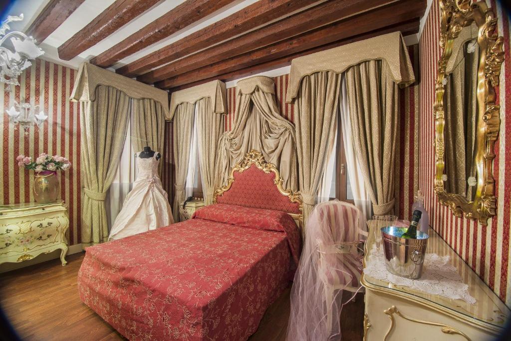 Un ou plusieurs lits dans un hébergement de l'établissement Dimora Dogale