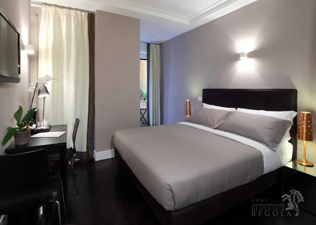 A bed or beds in a room at Residence Regola