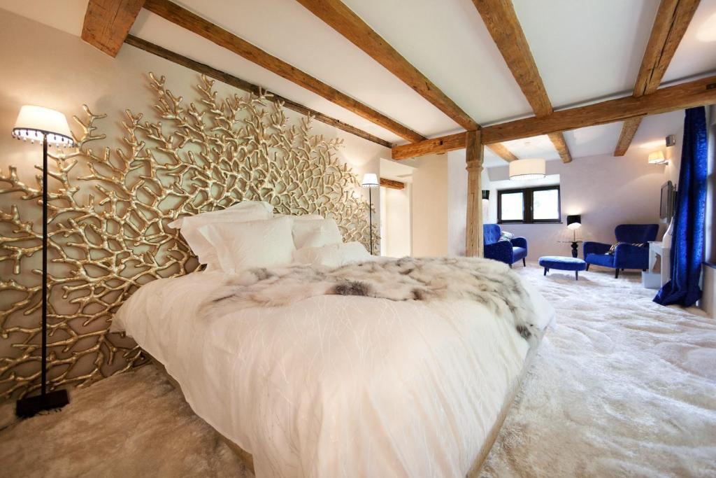 Кровать или кровати в номере Maison d'hôtes de coeur et d'exception - Du coté de chez Anne