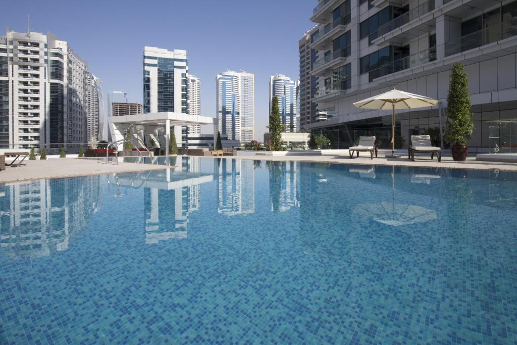 The swimming pool at or near La Verda Suites and Villas Dubai Marina