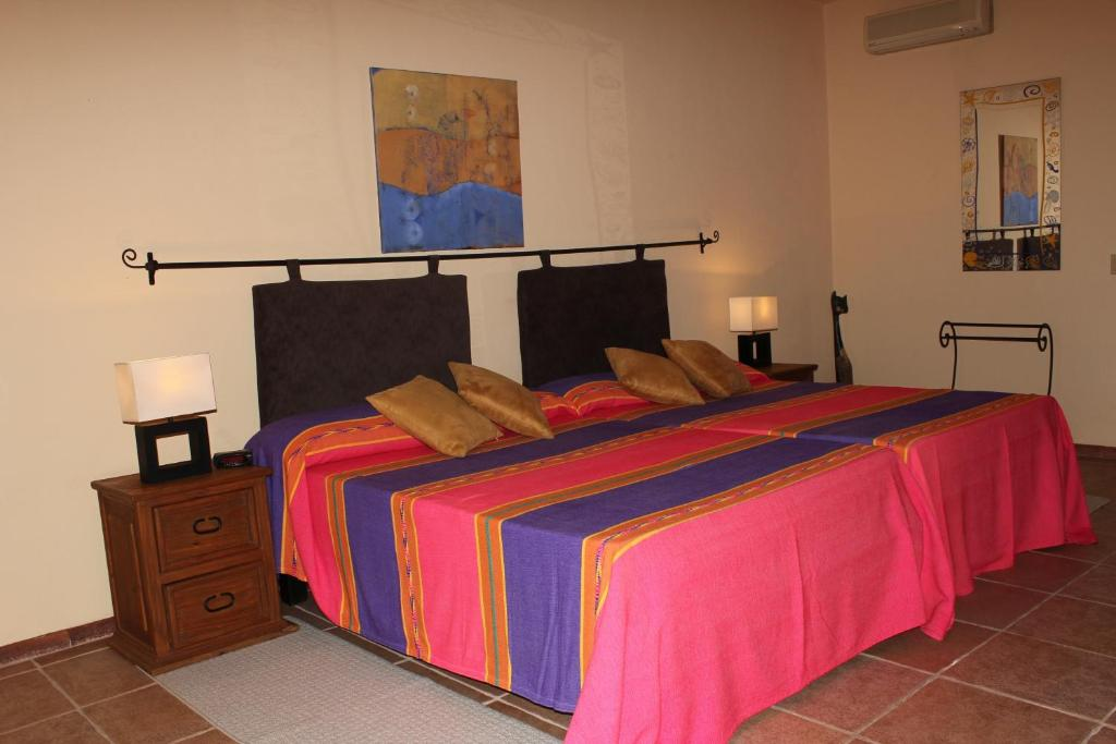 A bed or beds in a room at Hotel Posada La Poza