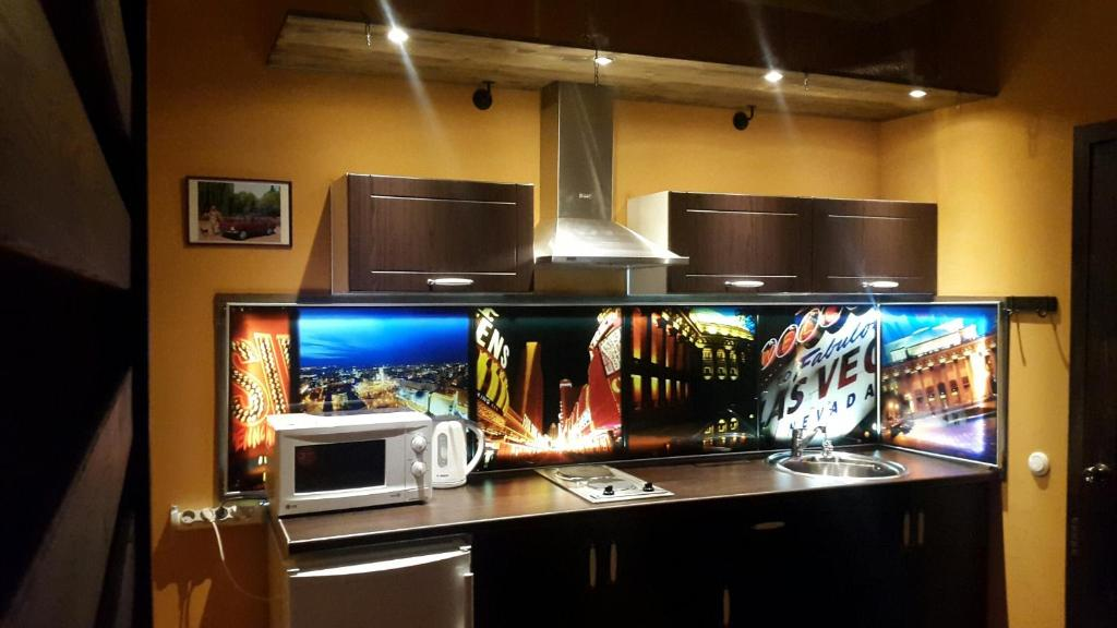A television and/or entertainment centre at Apartment on Lenina 18