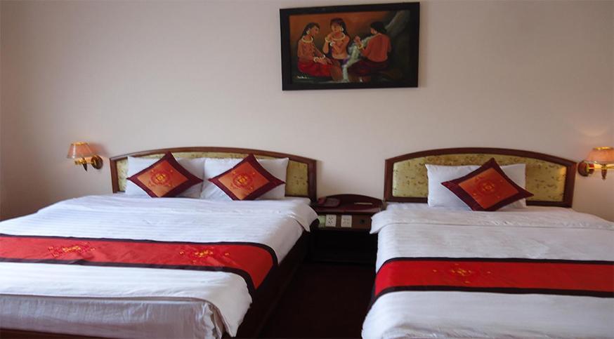 Giường trong phòng chung tại Sepon Hotel
