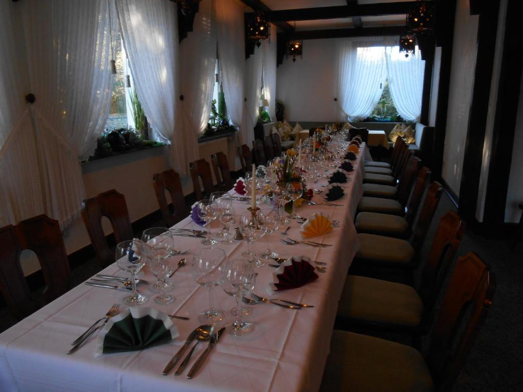 Ein Restaurant oder anderes Speiselokal in der Unterkunft Haus Von Der Heyde