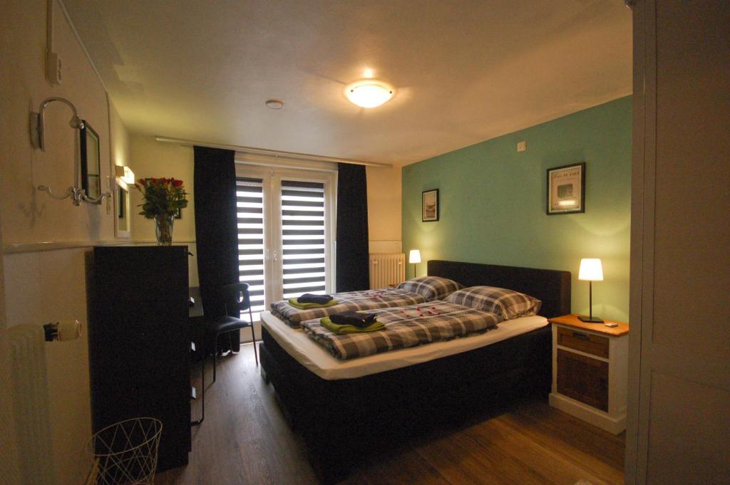 Een bed of bedden in een kamer bij Bed & Breakfast De Pegel Thorn