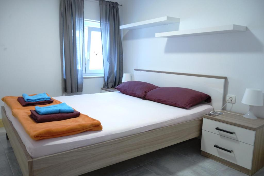 A bed or beds in a room at Hostel Pirano