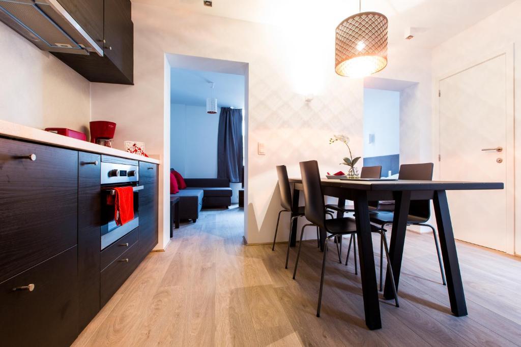 A kitchen or kitchenette at Cityzen Apartments Fine Arts