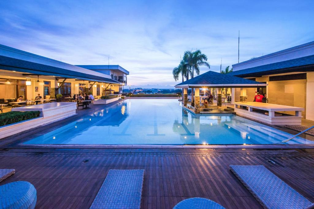 The swimming pool at or near L'Fisher Hotel Bacolod