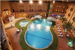 A view of the pool at Majan Continental Hotel or nearby