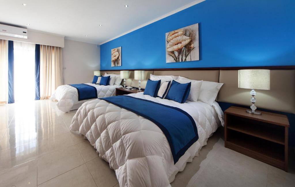 Un ou plusieurs lits dans un hébergement de l'établissement Port View Guesthouse
