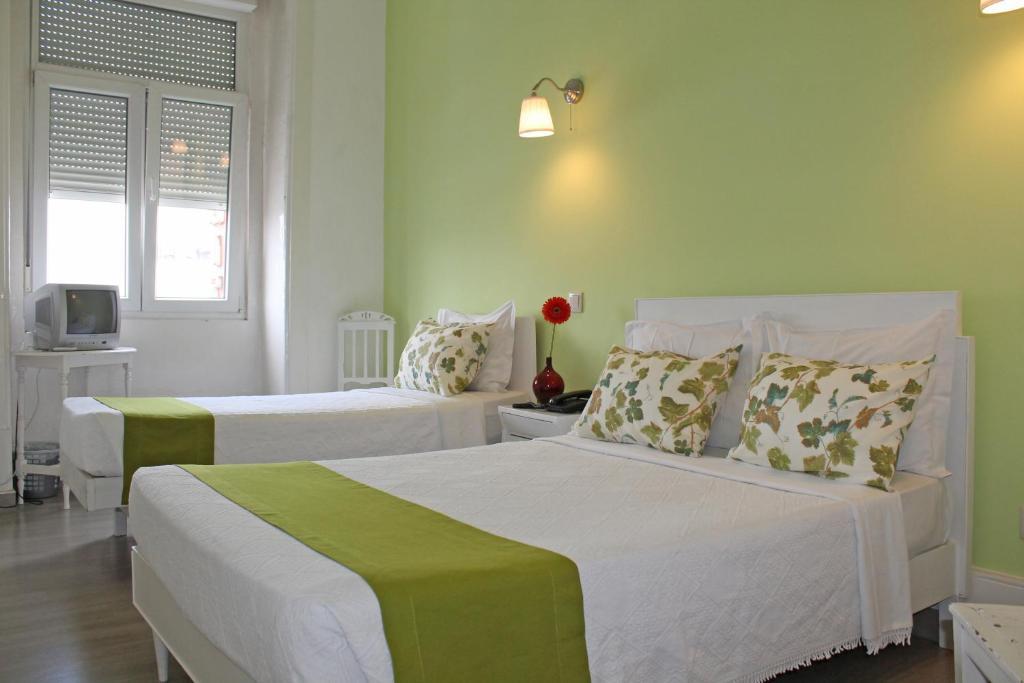 Letto o letti in una camera di Hotel Poveira