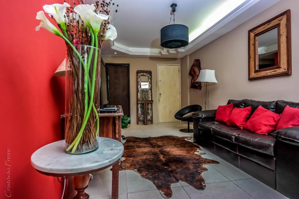 A seating area at Quartos E Suite Em Boa Viagem