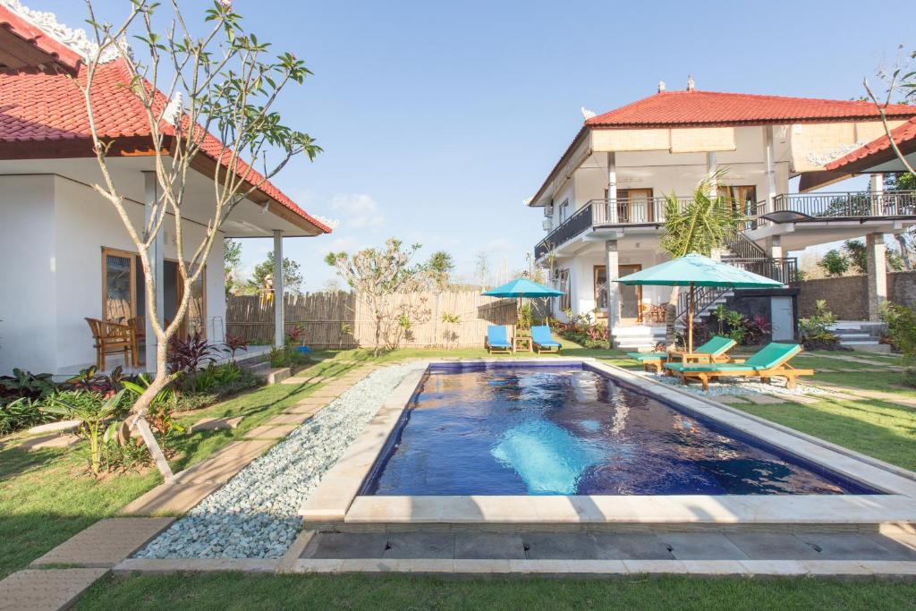 The swimming pool at or near Bingin Surf Left Guesthouse by Bukit Vista