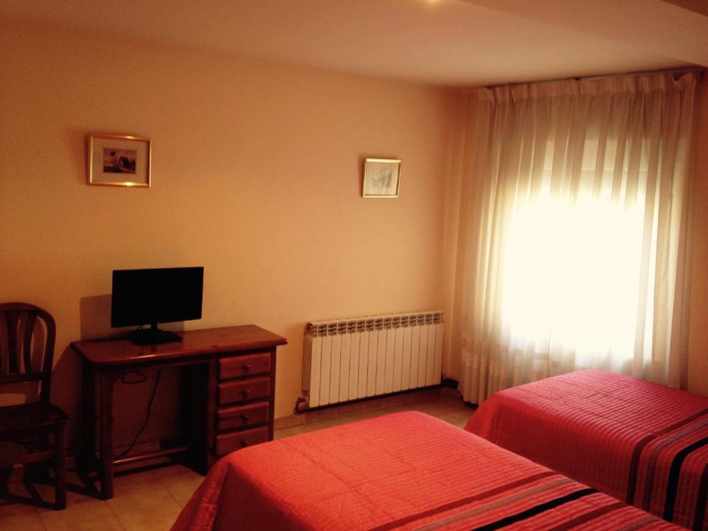 Cama o camas de una habitación en Hostal Nicolás