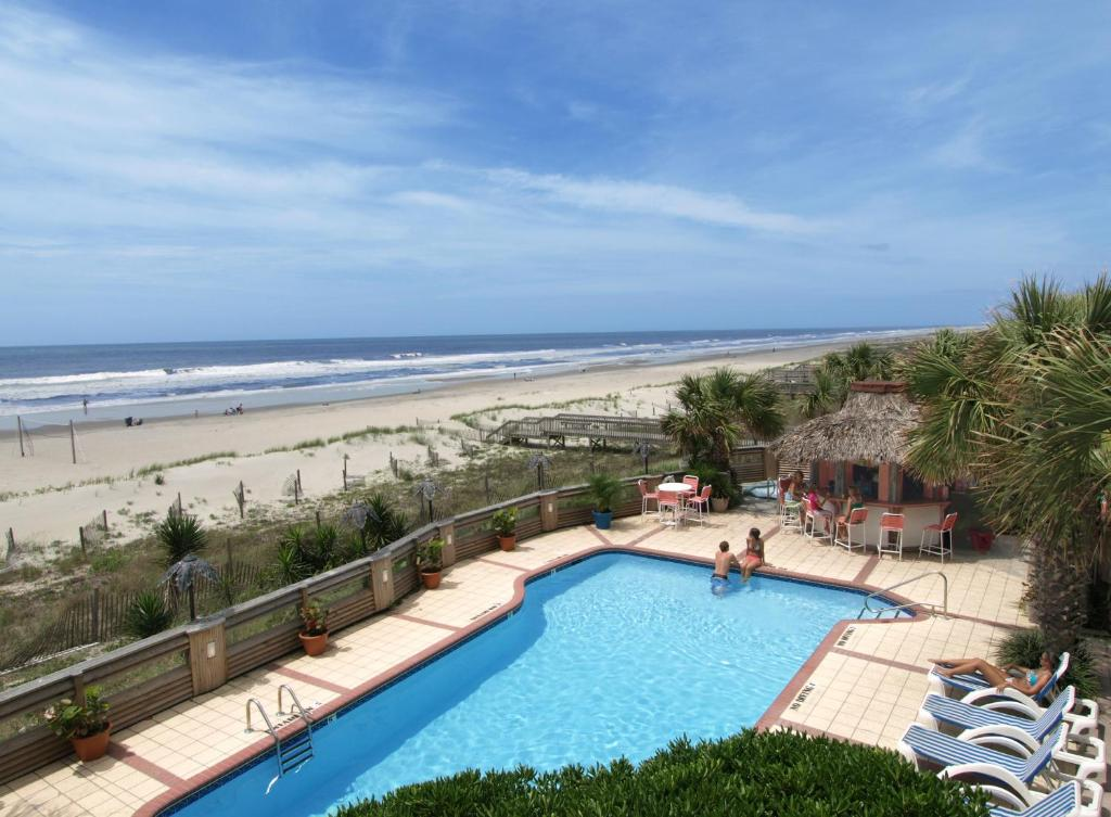 A view of the pool at The Winds Resort Beach Club or nearby