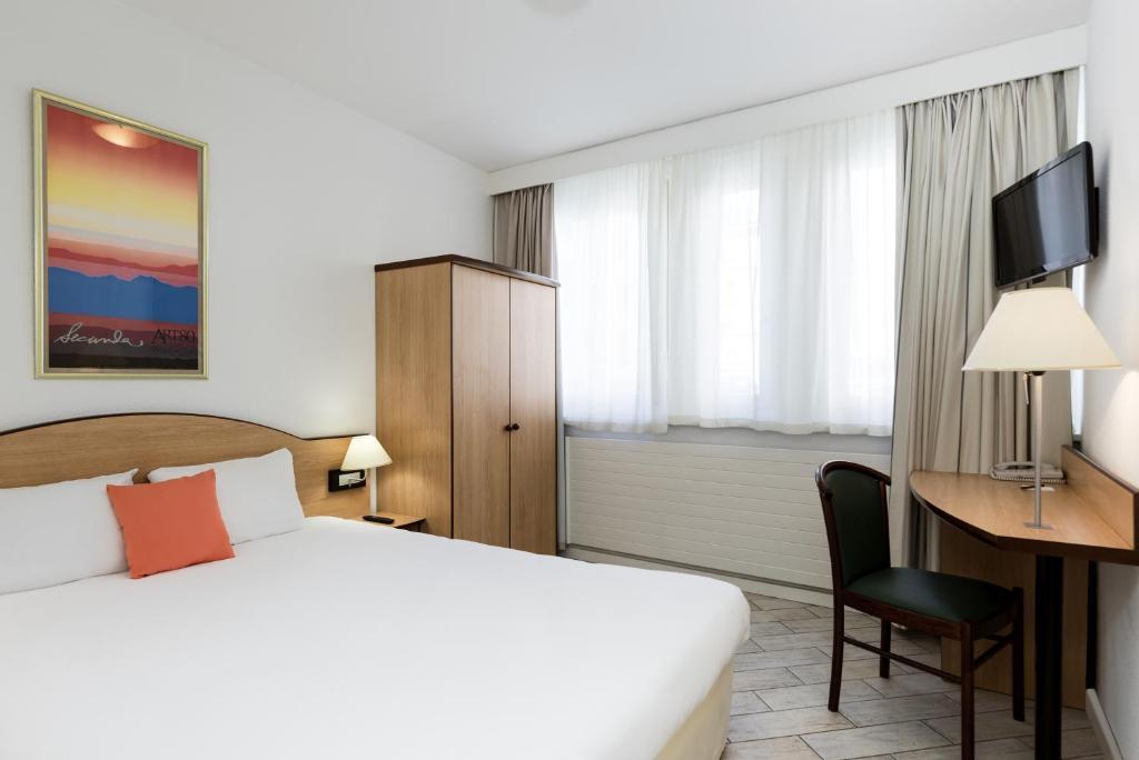 Cama ou camas em um quarto em Résidence Studio Genève Centre