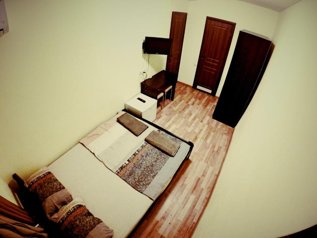 A bed or beds in a room at 3d Hostel