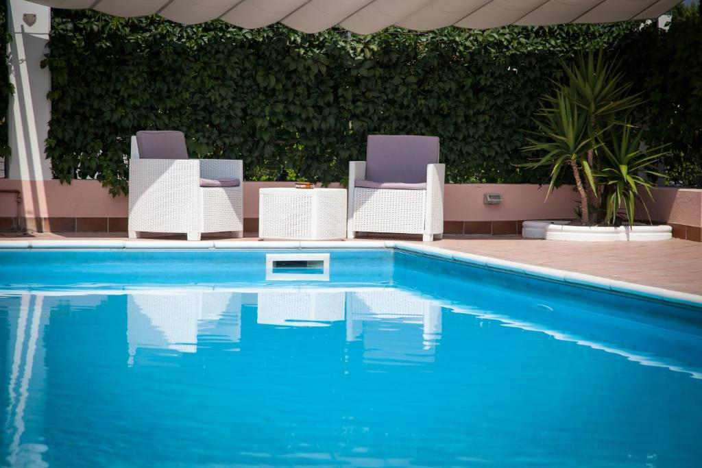 The swimming pool at or near Hotel Master