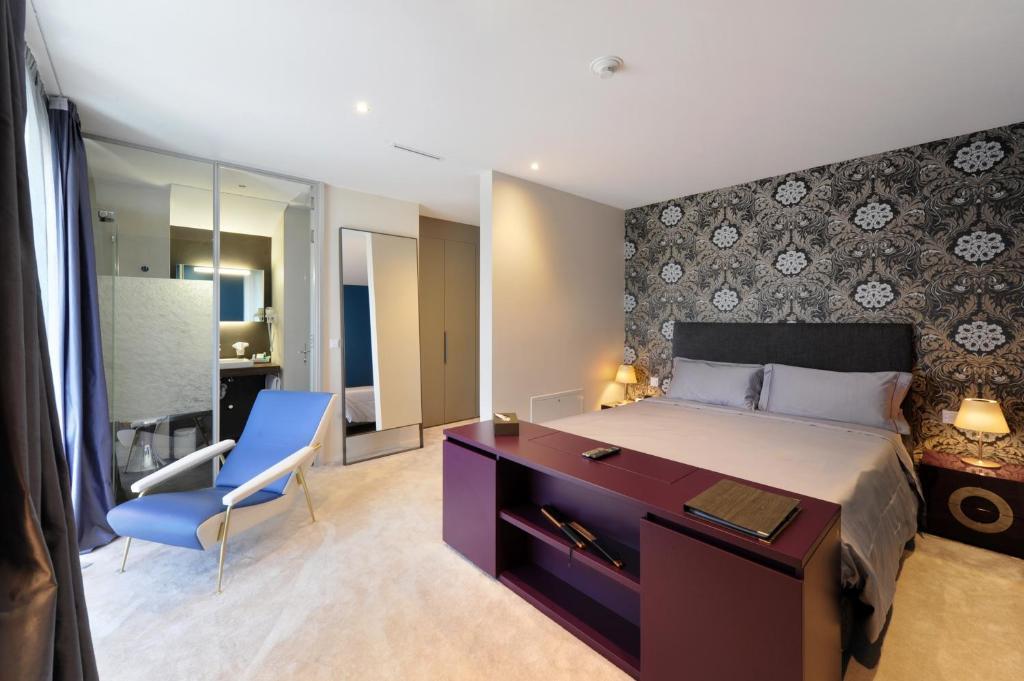 سرير أو أسرّة في غرفة في فندق دو نور