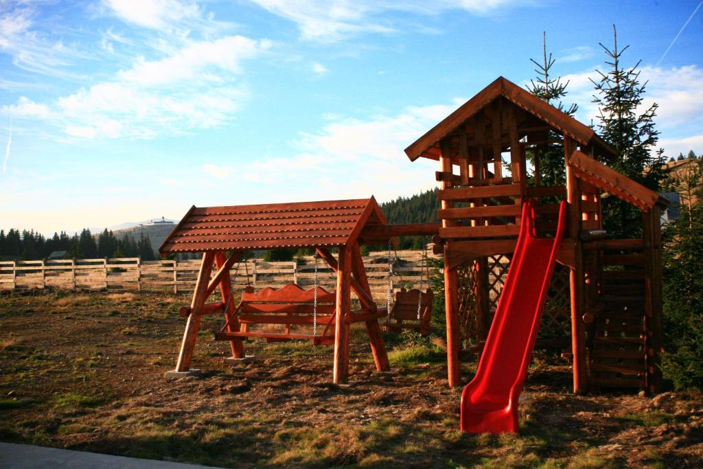 Children's play area at Pensiunea Muntele Alb