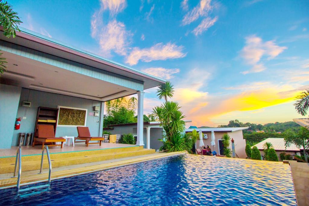 The swimming pool at or near Naiharn Retreat Resort
