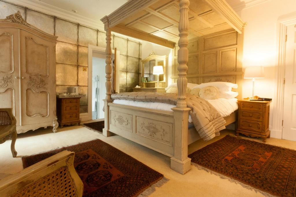 A bed or beds in a room at Meifod Country House
