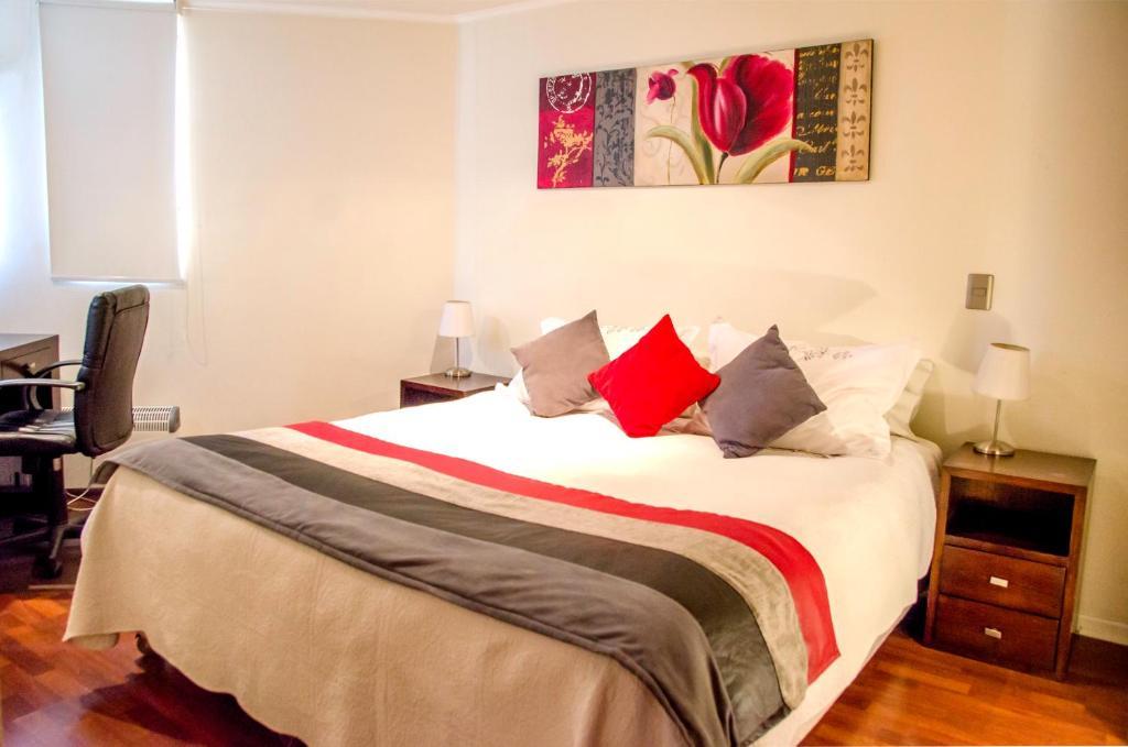 Cama o camas de una habitación en San Ignacio Suite Apartments