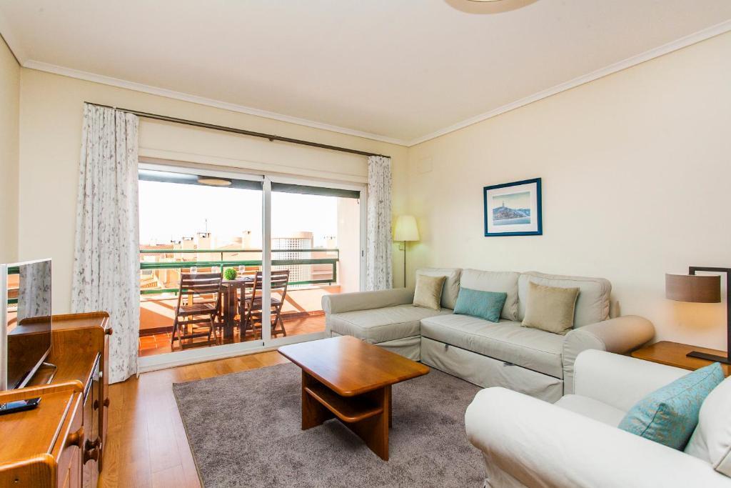 A seating area at Rosa dos Ventos Apartment