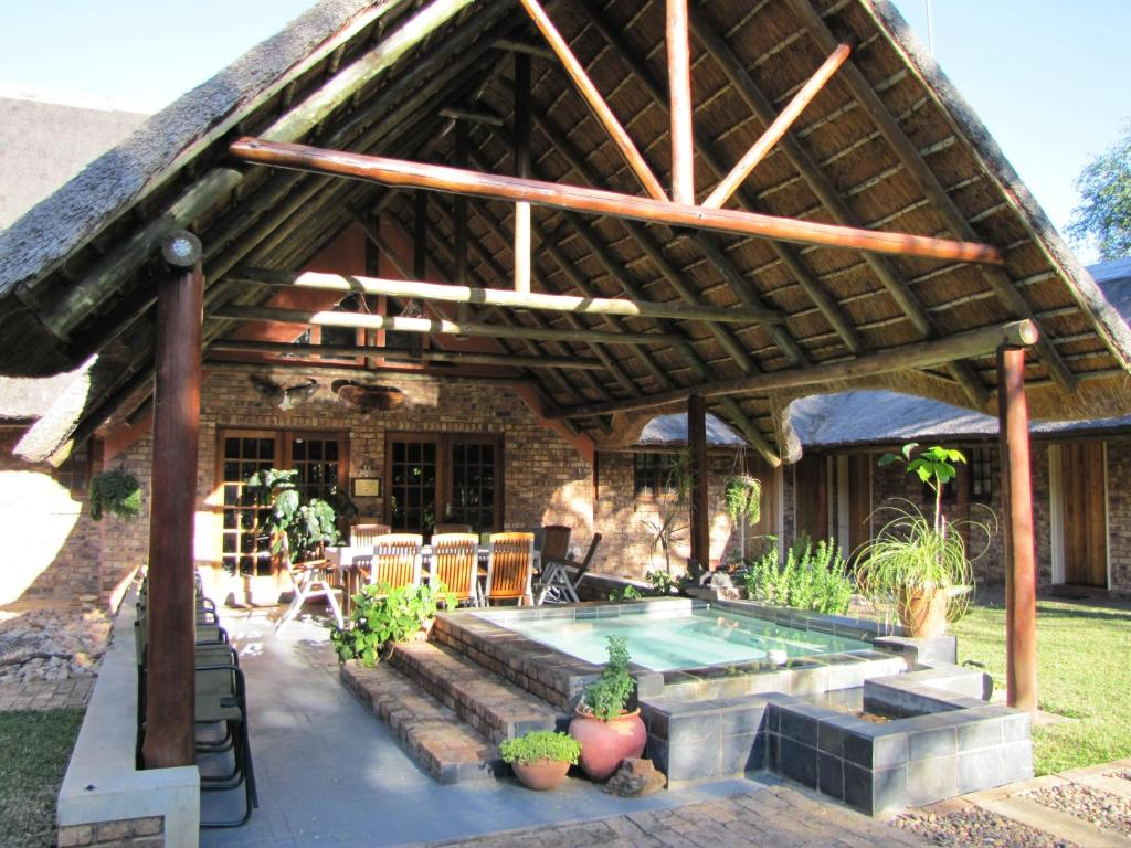The swimming pool at or close to Serenity Du Bois Lodge