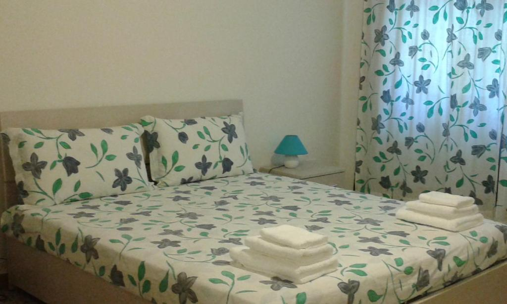 A bed or beds in a room at Appartamento Pacinotti