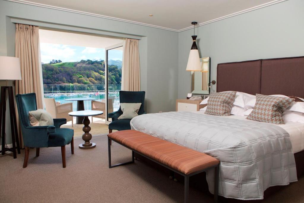 A bed or beds in a room at Dart Marina Hotel