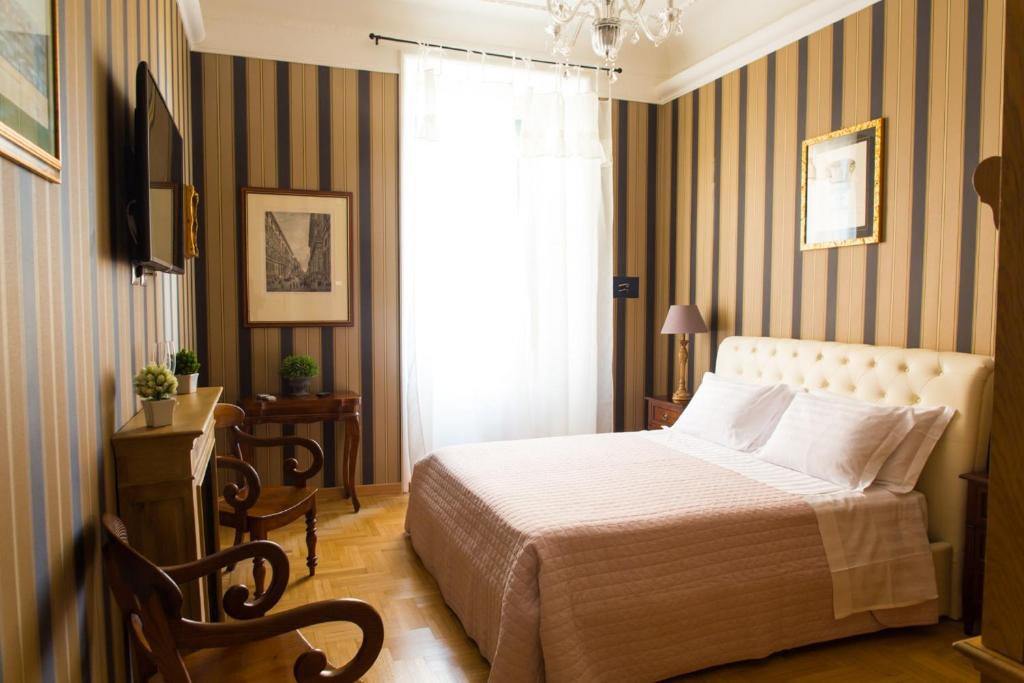 A bed or beds in a room at Landlord in Trastevere