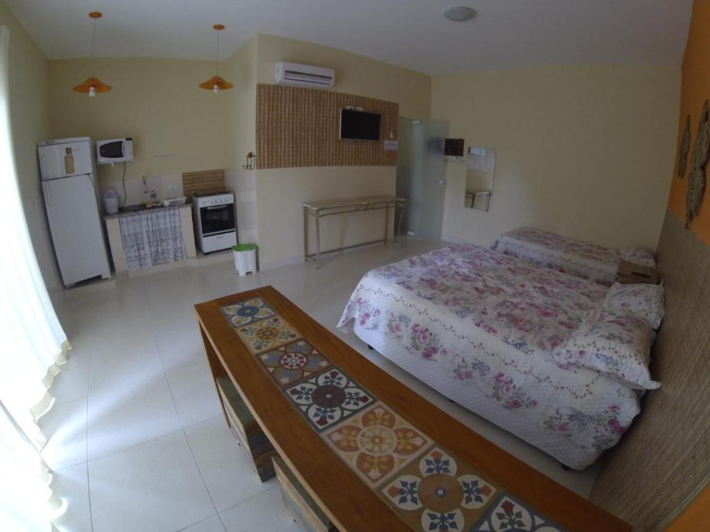 A bed or beds in a room at Casa do Monge Apartments