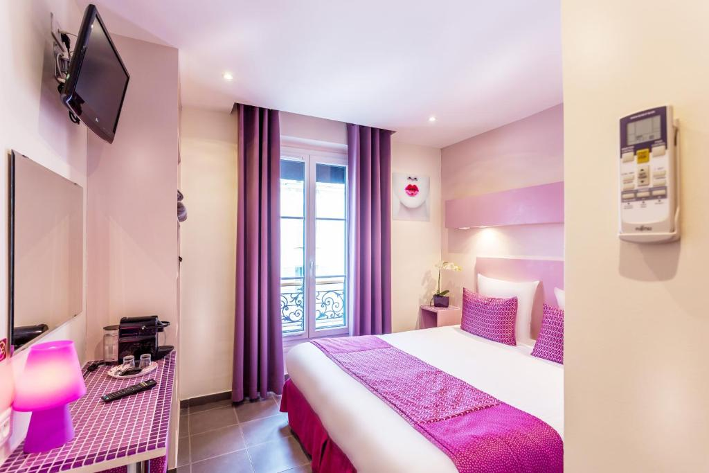 A bed or beds in a room at Pink Hotel