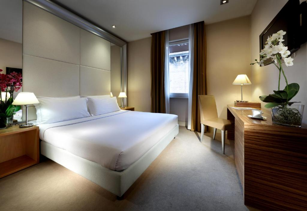 A bed or beds in a room at Eurostars Saint John