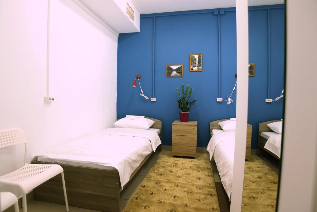 Кровать или кровати в номере Хостел Три Матрёшки