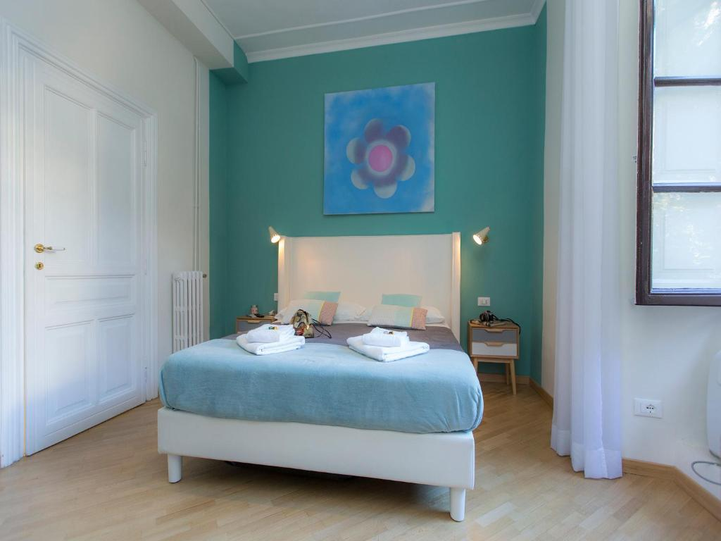 Letto o letti in una camera di Al 7 Small Luxury Rooms