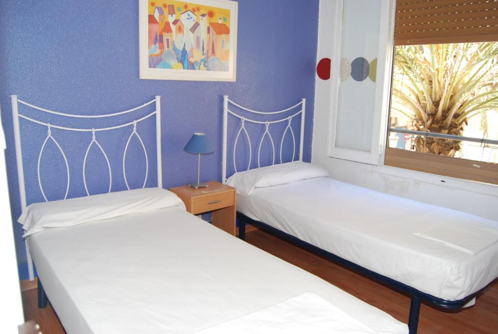 A bed or beds in a room at Russafa Youth Hostel