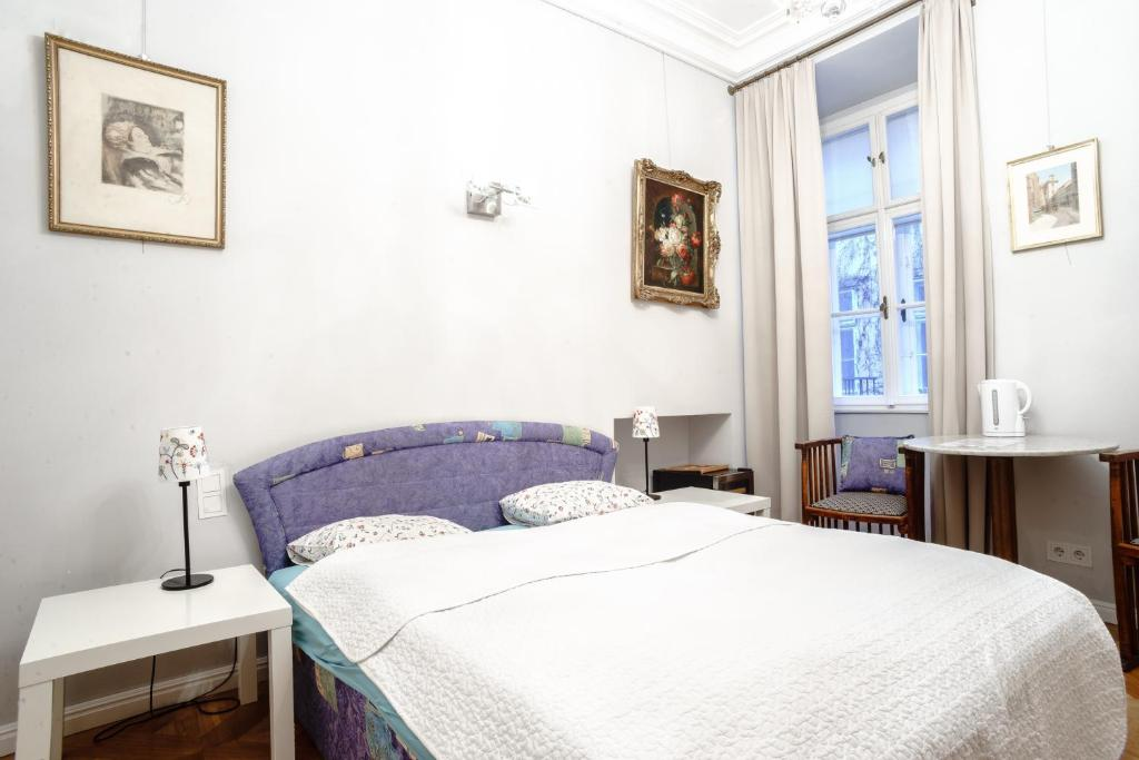 Ein Bett oder Betten in einem Zimmer der Unterkunft Living Vienna City Center