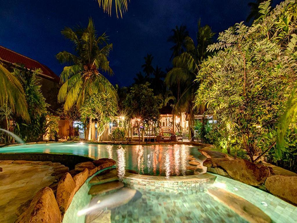 Piscine de l'établissement Ganesh Lodge ou située à proximité