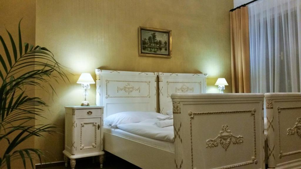 A bed or beds in a room at Old Prague House