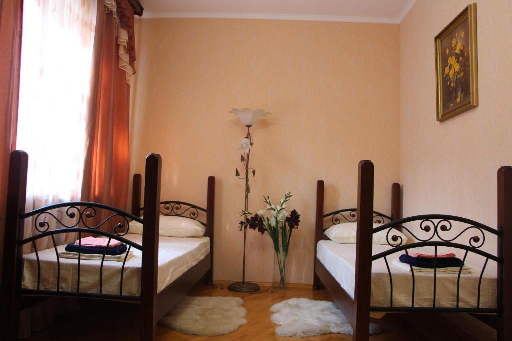 Кровать или кровати в номере Хостел Центральный на Гоголя