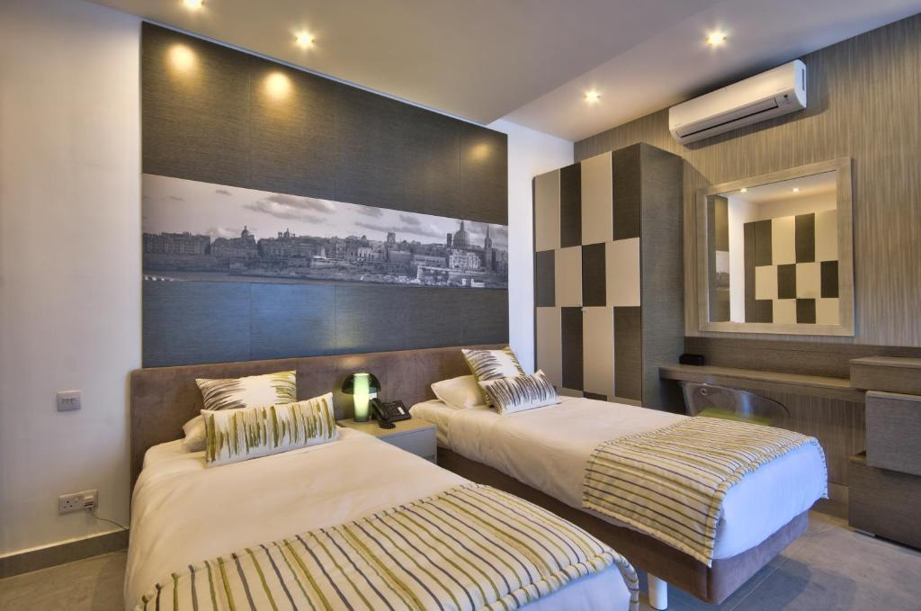 A bed or beds in a room at Jules Suites