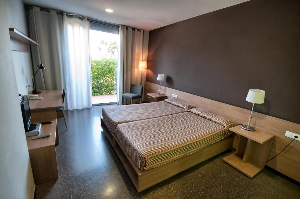Un ou plusieurs lits dans un hébergement de l'établissement Àgora BCN. Residencia Universitaria Internacional