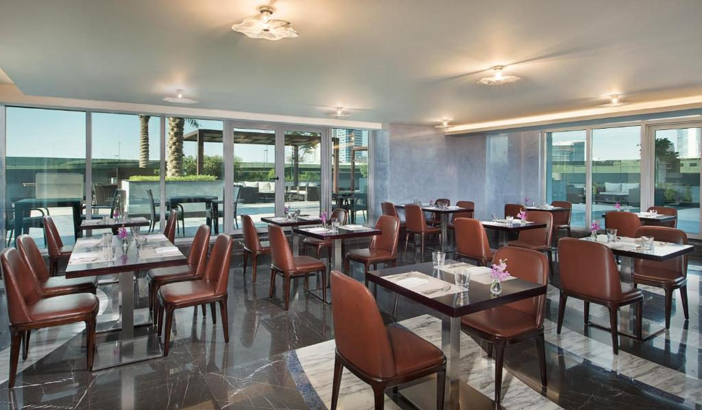 A restaurant or other place to eat at Atana Hotel