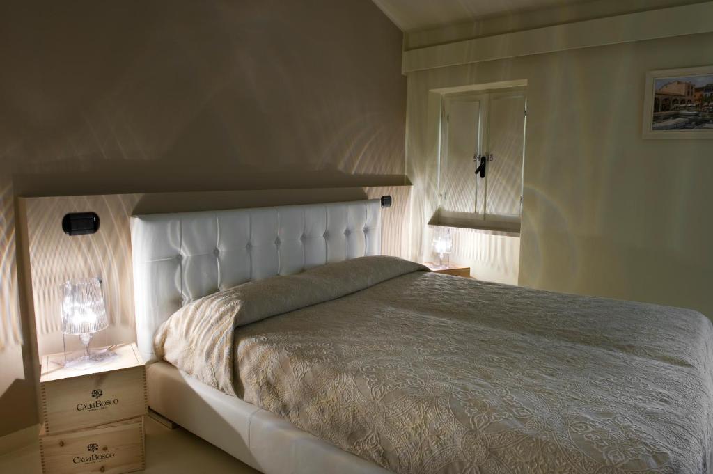 Letto o letti in una camera di Alessi Hotel