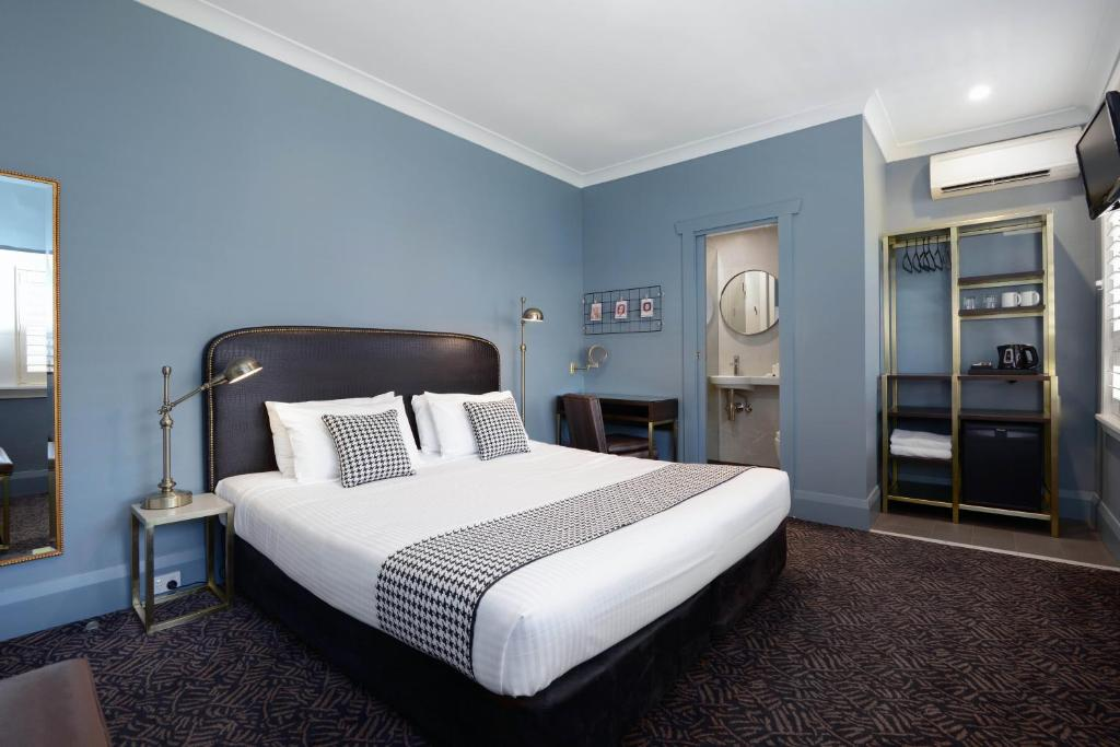 A bed or beds in a room at The Maisonette